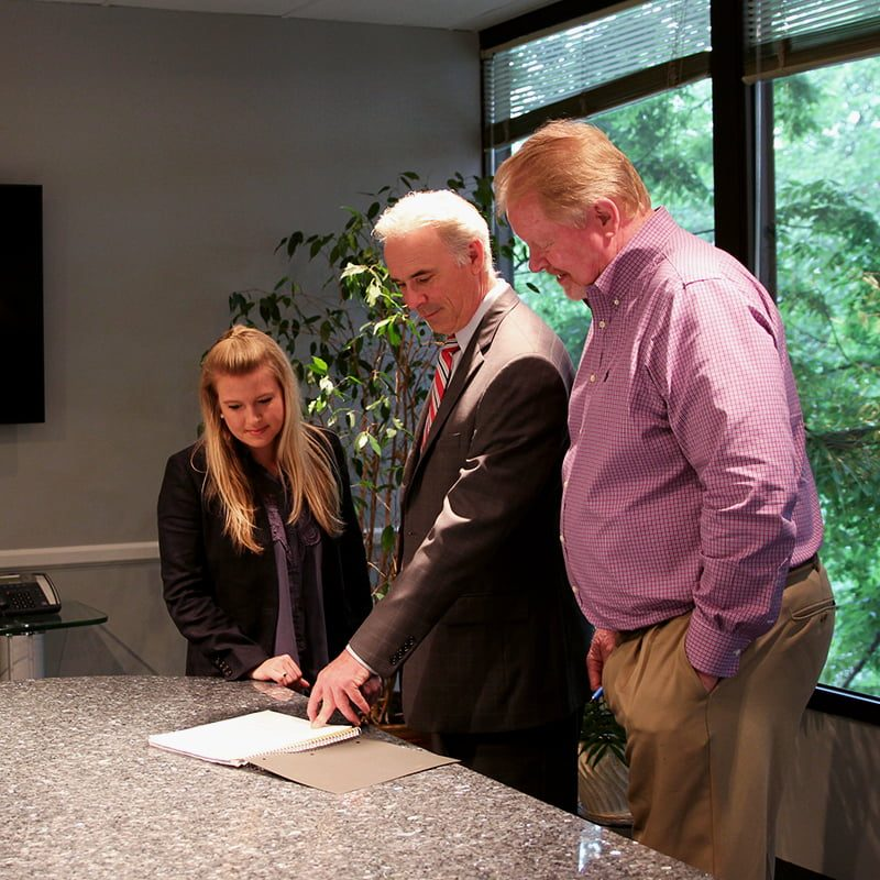 team of attorneys reviewing documents